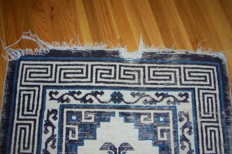 oriental rug tear fringes
